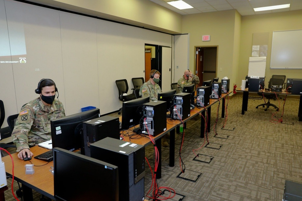 U.S. Army soldiers run simulations.